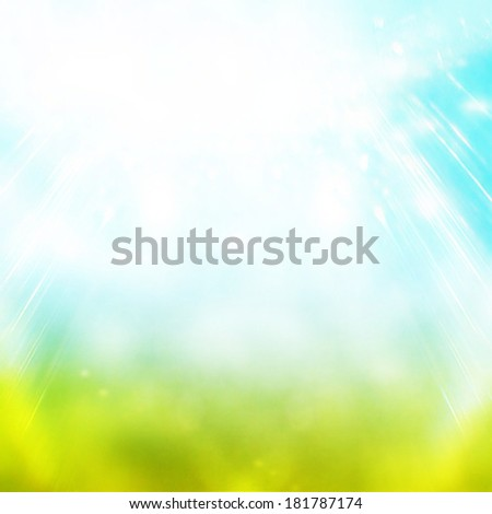 Beautiful summer easter background with beautiful green grass and blue sky colors and sun light - stock photo