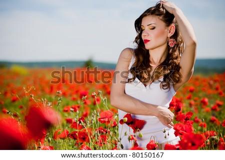 beautiful summer girl  in a poppy field - stock photo