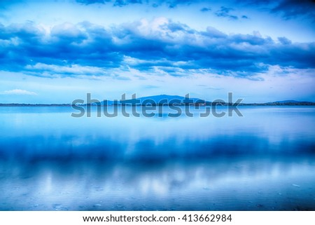 Beautiful summer landscape with cloudy sky, mountain and natural lake in Poland. HDR image - stock photo