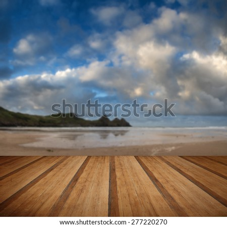 Beautiful Summer morning landscape over yellow sandy beach with wooden planks floor - stock photo