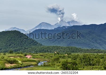 Beautiful summer mountain landscape of Kamchatka: eruption active Zhupanovsky Volcano. Eurasia, Russia, Far East, Kamchatka Peninsula. - stock photo