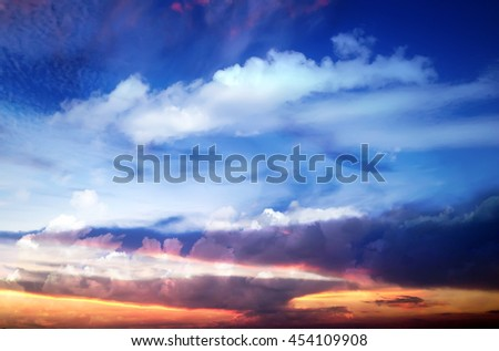 Beautiful summer purple sunset on the background of white clouds - stock photo