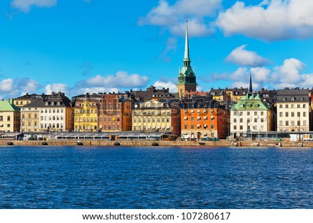 Beautiful summer scenery of the Old Town (Gamla Stan) pier and skyline in Stockholm, Sweden