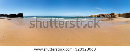 Beautiful summer seashore with rocky hills, Portugal - stock photo