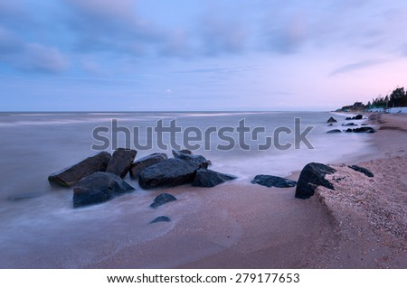 Beautiful summer sunset at the sea with stones in Ukraine
