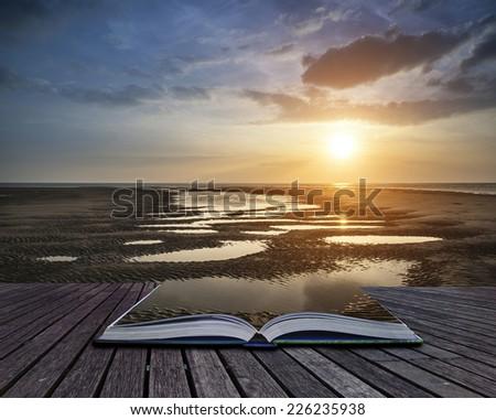 Beautiful Summer sunset over golden beach landscape conceptual book image - stock photo
