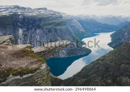 Beautiful summer vibrant view on famous Norwegian tourist place - trolltunga, the trolls tongue with a lake and mountains, Norway, Odda. - stock photo