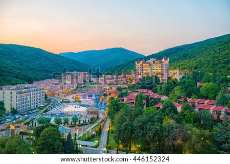 beautiful sundown summer high angle view of hotels, apartments, parking, aquapark, mountain and forest, Elenite, Bulgaria