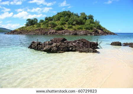 Beautiful sunny caribbean beach and transparent water - stock photo