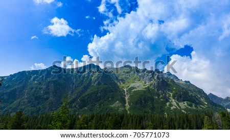 Beautiful sunny cloudy mountain landscape. High Tatras