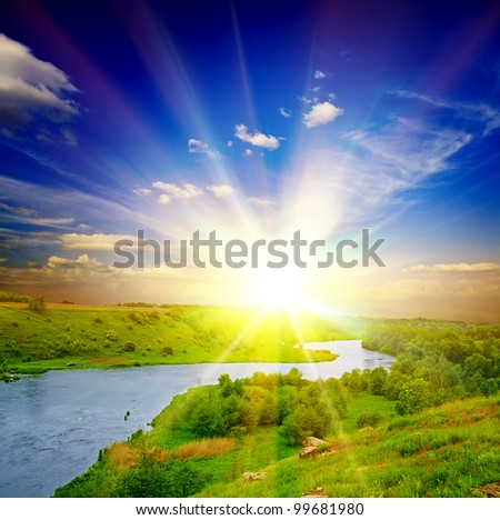 beautiful sunny landscape with field and forest - stock photo