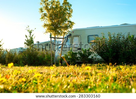 Beautiful sunny morning in the camping site - stock photo