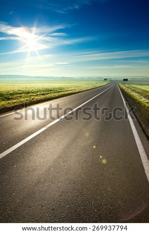 Beautiful sunny road in the morning - stock photo