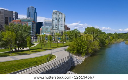 Beautiful sunny summer day in Calgary Downtown; image taken from certre street bridge, overlooking north side of dowtown and Bow River.