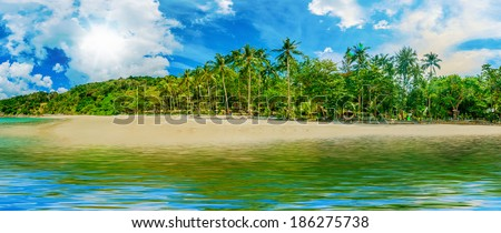 Beautiful sunny tropical beach on the island paradise in the middle of the sea - stock photo