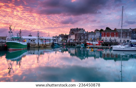 Beautiful sunrise across Padstow harbour on the Cornwall coast - stock photo