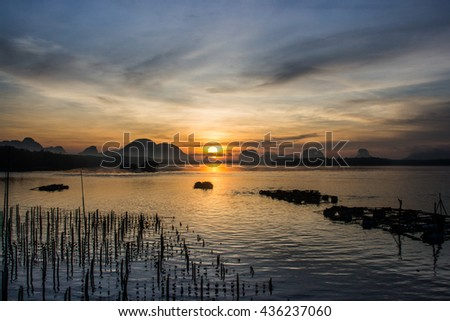 Beautiful sunrise at fisherman village, South of Thailand - Natural background - stock photo