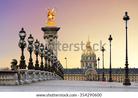 Beautiful sunrise at the Pont Alexandre III and Les Invalides in Paris - stock photo