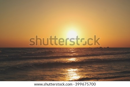 Beautiful sunrise at the sea with clear sky. Zakynthos Island. Summertime in Greece - stock photo