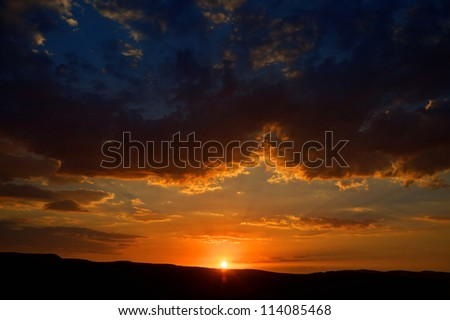 beautiful sunrise behind the mountains - stock photo