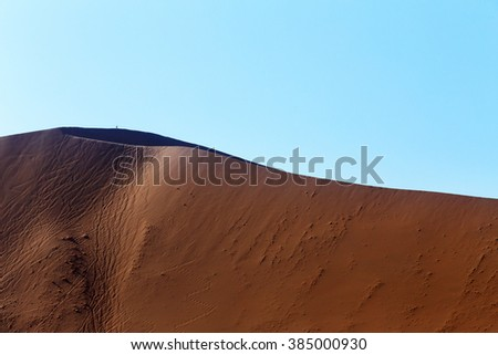 beautiful sunrise dune in hidden Dead Vlei in Namib desert with blue sky, this is best place of Namibia