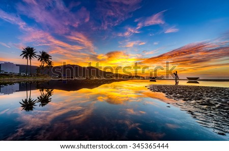 Beautiful Sunrise in the Da Nang Beach, The Most beutiful beach in the World... Da Nang Beach, Da Nang City, Vietnam - stock photo