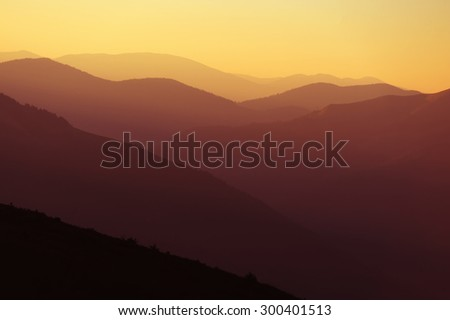 Beautiful sunrise in the mountains with a silhouette of the mountains