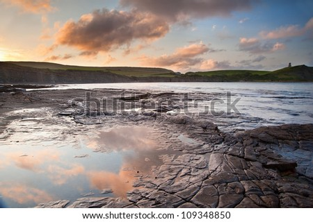 Beautiful sunrise landscape image at Kimmeridge Bay on Jurassic Coast, Dorset, England