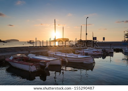 Beautiful sunrise landscape seascape of boats in harbour in Mediterranean Sea