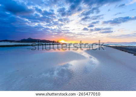 Beautiful sunrise on Alcudia beach, Majorca island, Spain - stock photo
