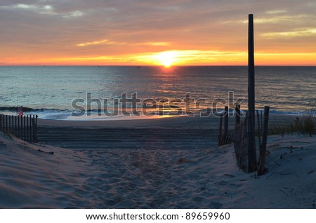 Beautiful Sunrise on the New Jersey Shore in late fall - stock photo