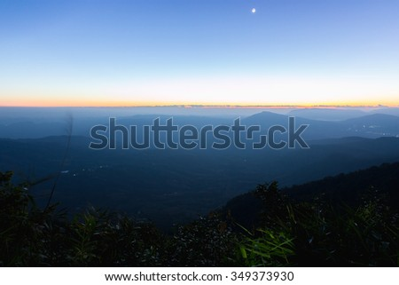 Beautiful Sunrise over a Silhouetted Horizon - stock photo