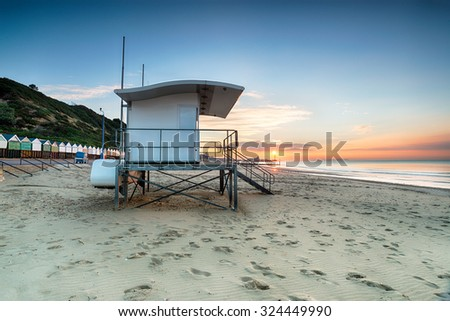 Beautiful sunrise over Bournemouth beach on the Dorset coast - stock photo
