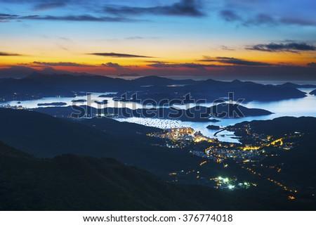 beautiful sunrise over hong kong coastline - stock photo