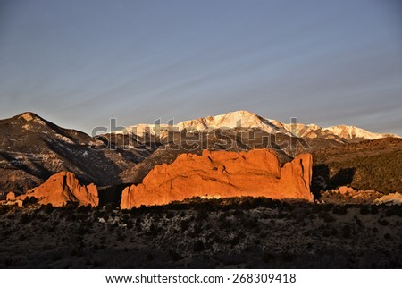 Beautiful sunrise over Pikes Peak and Garden of the Gods in Colorado Springs - stock photo