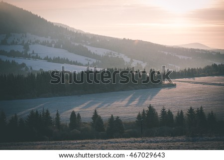 Beautiful sunrise over the countryside in winter - vintage film effect