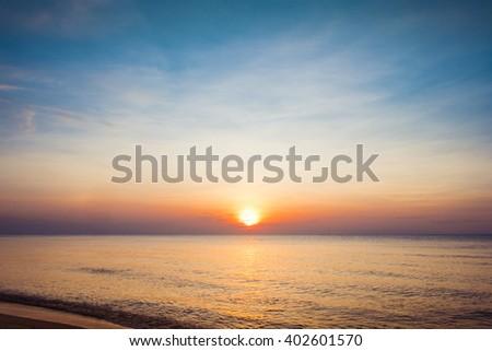 Beautiful sunrise over the horizon in the sea, Thailand. - stock photo