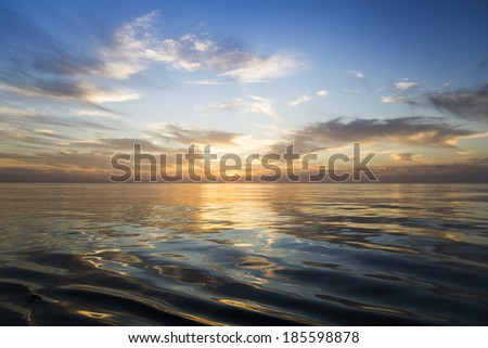 Beautiful sunrise over the sea. Calm. - stock photo