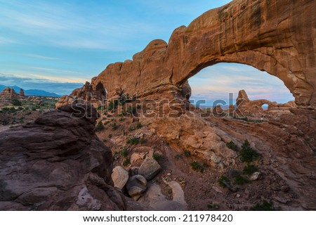 Beautiful sunrise over Turret Arch through North Window Arches National Park Utah - stock photo