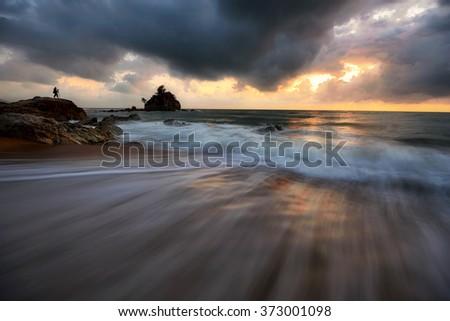 Beautiful sunrise seascape at Kemasik Beach, Terengganu. Soft focus due to long exposure shot. Nature composition. - stock photo