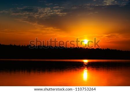 Beautiful Sunrise / Sunset over Calm Lake - stock photo