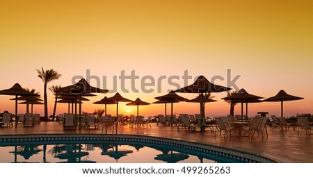 Beautiful sunrise with a view of the pool and the sea. Hurghada. Egypt