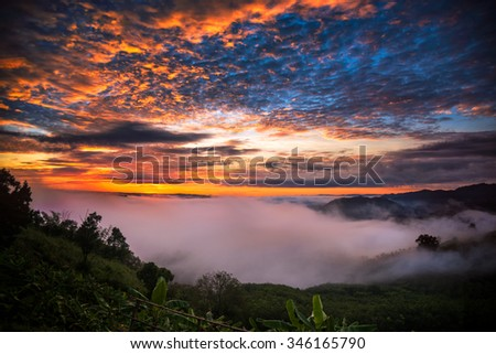 Beautiful sunrise with the morning mist at phu huay e-sun Nong Khai Province, Thailand