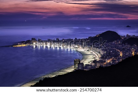Beautiful sunset above Copacabana Beach in Rio de Janeiro, Brazil - stock photo