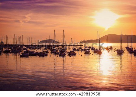 Beautiful sunset above many yachts in Mediterranean sea in Lerici, Italy.
