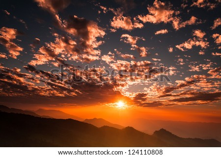 Beautiful sunset above the mountains. - stock photo