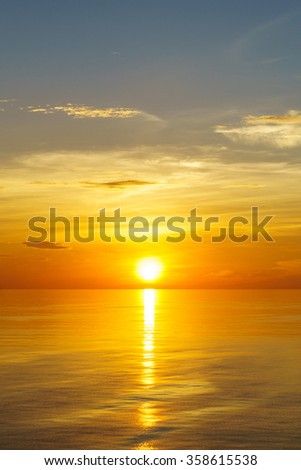 Beautiful sunset above the sea on vertical - stock photo