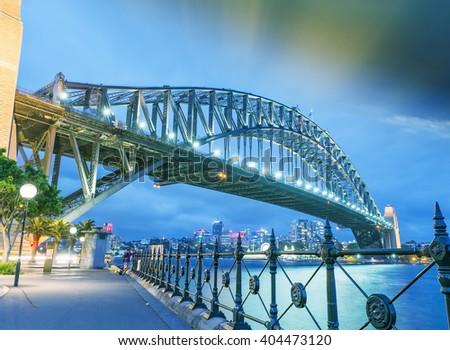 Beautiful sunset across Sydney Harbour Bridge. - stock photo