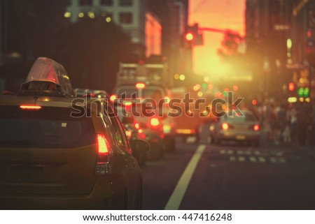 Beautiful sunset along a New York street blurred background and retro filter - stock photo