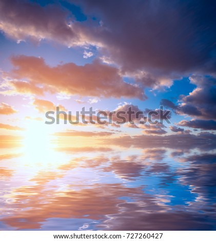 Beautiful sunset and clouds in the sky and a bright sunshine over the sea. Natural composition